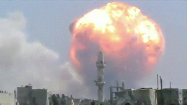An explosion from the arms depot near Homs killed dozens earlier this year (Courtesy of BBC)