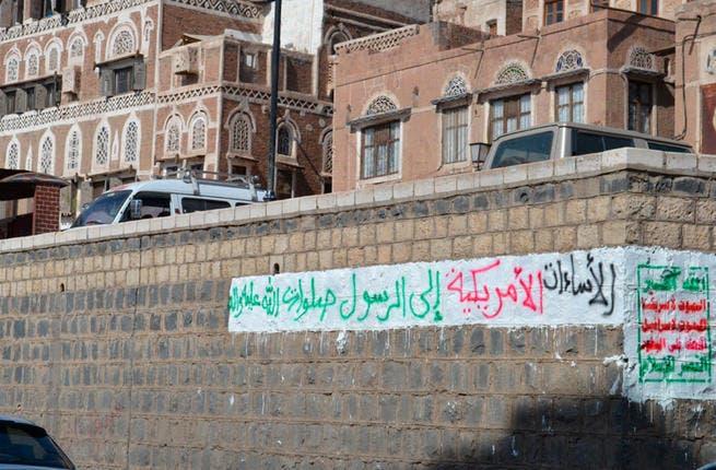 The Houthi slogans have spread across Yemen's capital (Yemen Times)
