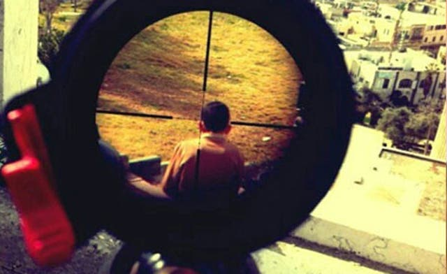 Mor Ostrovski, an Israeli soldier, posted this picture of a child in crosshairs of his rifle on his Instagram account. (Photo courtesy of electronicintifada.net)