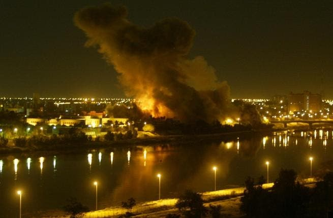 File picture dated March 20, 2003 shows smoke billowing after a missile hit the planning ministry in Baghdad as the Iraqi capital came under heavy US-led bombardment on the first day of the US-led invasion of Iraq that toppled Saddam Hussein. (AFP / Ramzi Haidar)