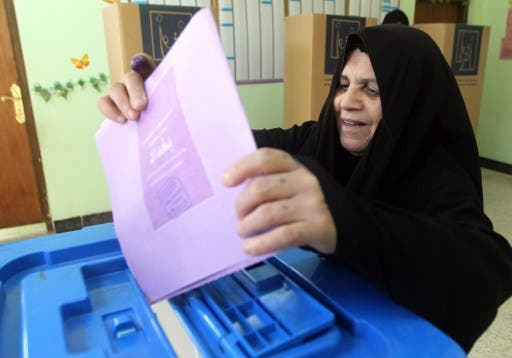 An Iraqi woman casts a ballot at a polling station during provincial elections on April 20, 2013 in Baghdad's Sadr City district. (Photo: AFP PHOTO/AHMAD AL-RUBAYE)