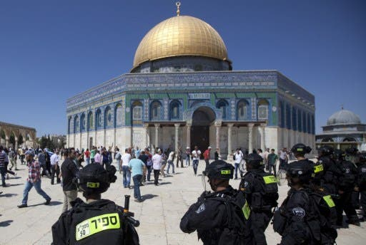 JERUSALEM : Israeli riot policemen stand near the Dome of the Rock mosque during clashes with Palestinian stone-throwers (unseen) following Friday prayers at Jerusalem's al-Aqsa mosque compound on September 6, 2013. (AFP)