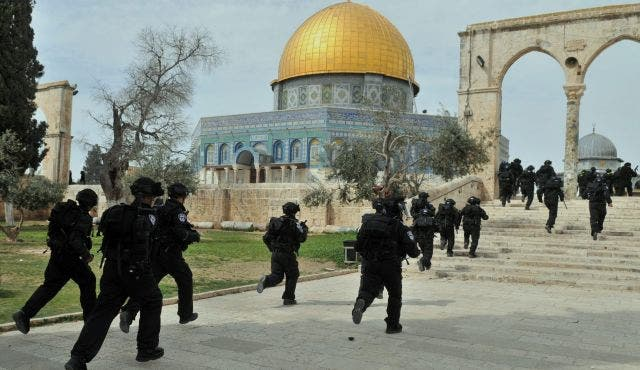After they entered the Al Aqsa mosque compound under armed guard, Israelis clashed with Palestinian Muslim worshippers in Jerusalem on Wednesday (AFP/File)