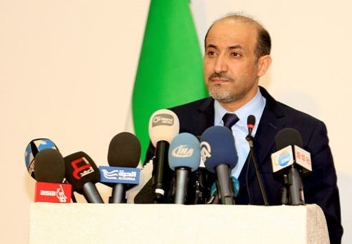 Syrian opposition National Coalition president Ahmad Jarba announced the group's participation in the Swiss peace talks on Saturday (AFP/Syria National Coalition Media Office/Mohammed Ziadeh)