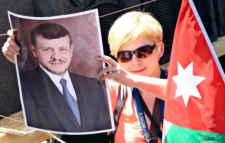 A pro-government supporter holds a picture of Jordan's King Abdullah in Amman in April 2012. (Photo: Muhammad Hamed)
