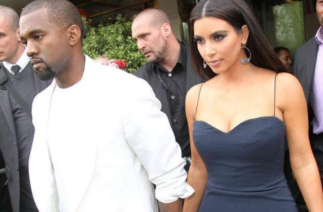 Kanye West has urged Kim Kardashian to slow down following a recent health scare.