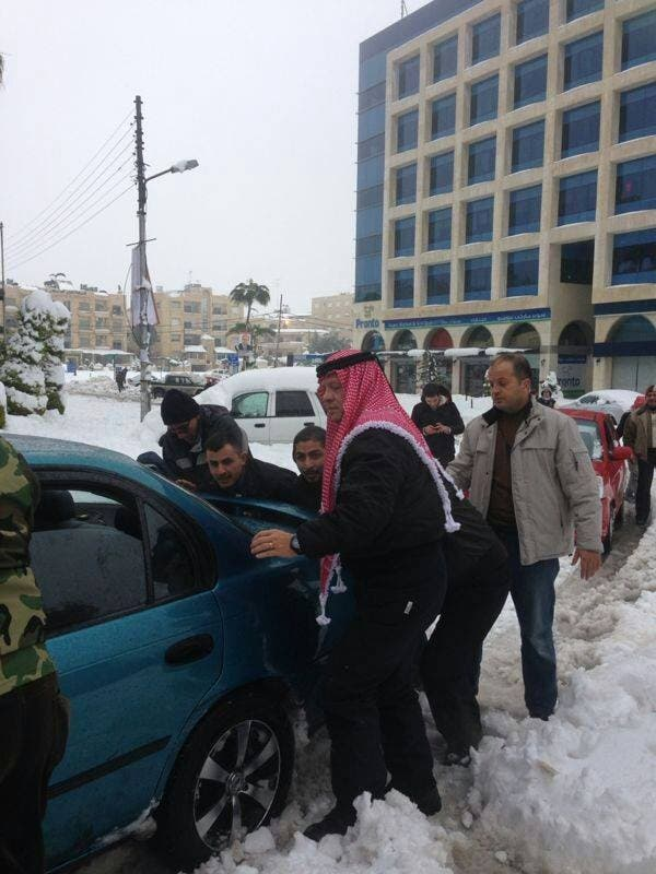 Jordan's King Abdullah went to the streets Saturday to help residents dig their cars out from layers of snow that has trapped many people throughout the Kingdom (Courtesy of Jordan Times)