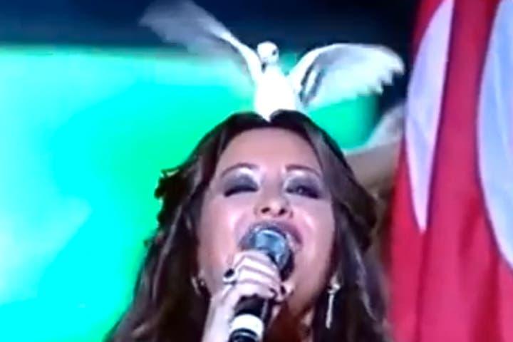 The funny moment a dove landed on Latifa's head. (Image: YouTube screenshot)