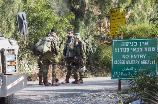 More Israeli soldiers were deployed to the border area after a Lebanese sniper shot an Israeli soldier this week (JAck Guez/AFP)