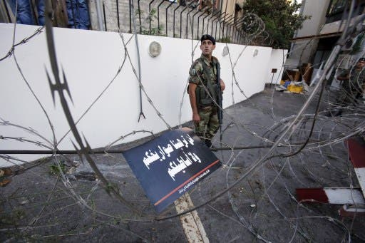 Lebanese soldiers block a road leading to the American embassy in eastern Beirut. (AFP)