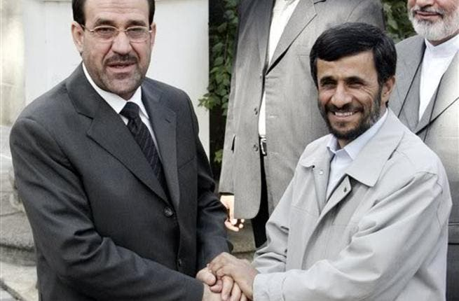 Iraqi PM Nouri Al Maliki and Iranian president Ahmadinejad