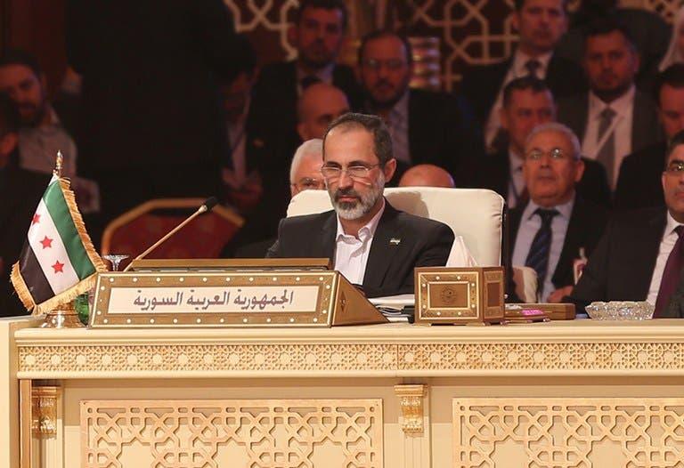 Moaz al-Khatib attends the Arab League summit in Doha (AFP Photo)