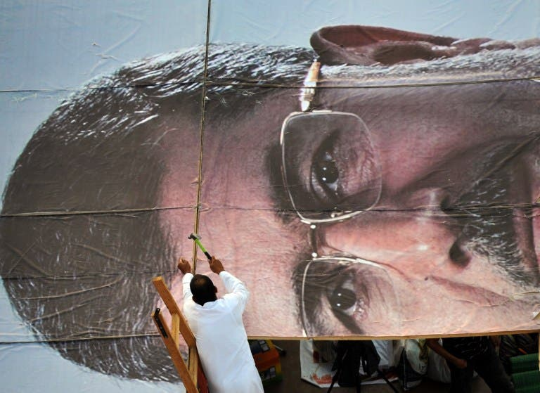 A supporter builds a giant portrait of deposed president Mohammad Morsi on July 25 in Cairo. (AFP / Fayez Nureldine)