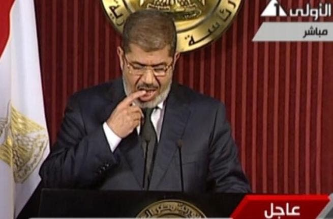 """Morsi's spontaneous """"finger-licking"""" as he turned the pages of his speech was the center of many jokes and sarcastic comments on Twitter (Photo: Egypt's state TV)"""