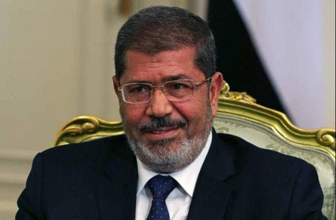 President Mohamed Morsi hails from the Brotherhood, which the opposition accuses of seeking to tighten its hold on power.