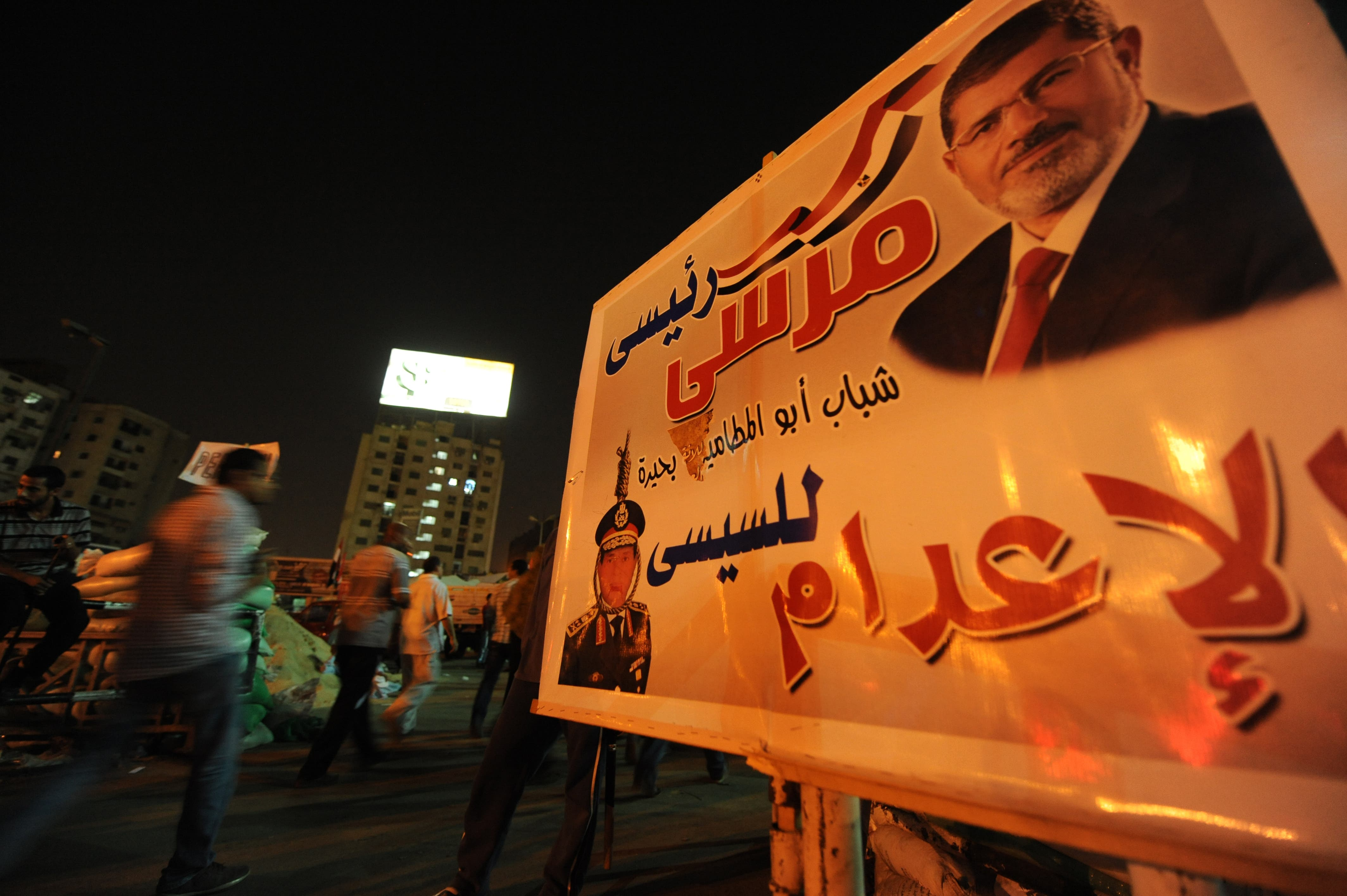 A protest sign showing deposed president Mohamed Morsi hangs in Cairo on July 31. (AFP / Fayez Nureldine)