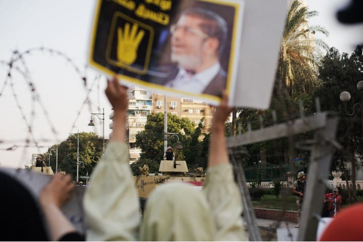 Hundreds of Muslim Brotherhood members and supporters of ousted President Mohammed Morsi, rally outside the Presidential Palace. (Image credit: AFP)