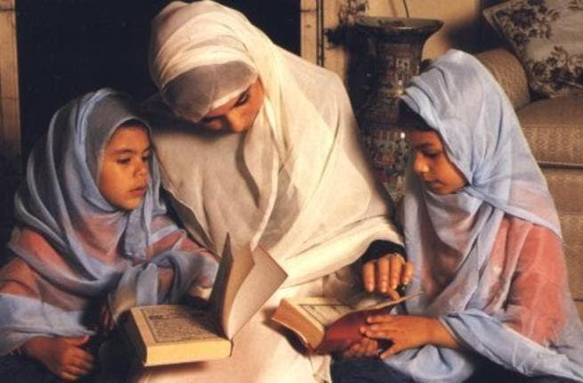 Muslim families reading and reciting the holy Quran
