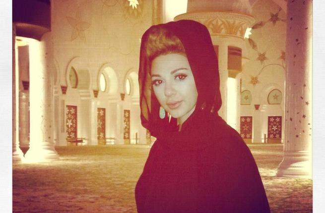 Myriam covered up for a visit to Abu Dhabi's Sheikh Zayed Mosque (Photo: Facebook)