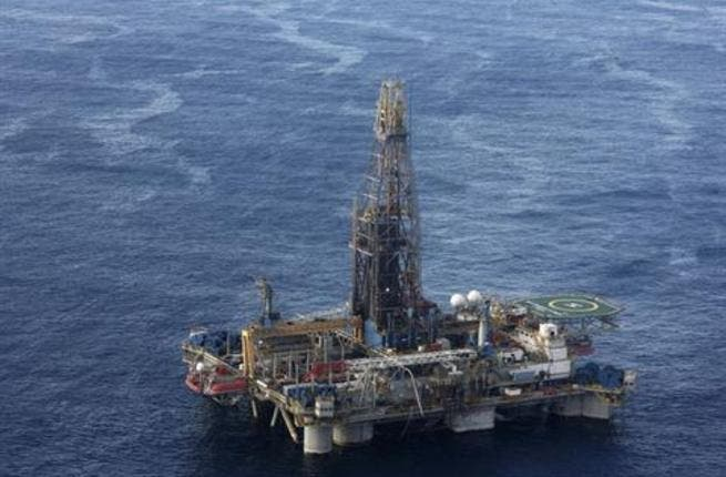 n this photo provided by the Cyprus Press and Information office, the Noble Energy company's offshore oil and gas rig is seen some 115 miles (185 kilometers) off Cyprus' south coast.