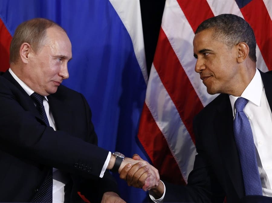 Obama called his counterpart Vladimir Putin Tuesday to discuss the Syrian peace conference set to begin Wednesday in the Swiss city of Montreux (File Archive/AFP)