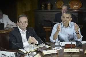 US President Barack Obama (R) and French President Francois Hollande attend a G8 session on May 19, 2012 in Maryland (AFP/File)