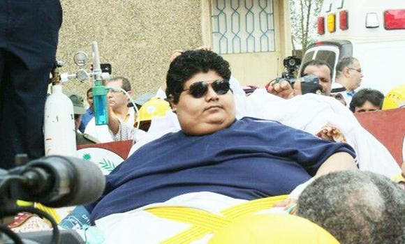 Saudi Khaled Mohsen Shaeri, who suffers from extreme obesity weighing 610 kilograms, is transported with a fork-lift truck on August 19, 2013 at the airport in Riyadh. (AFP)