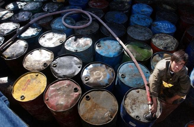 Dents in the Arab economy, like these rusty oil cans