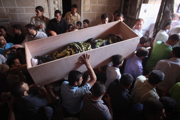 Palestinians burying their dead (image used for illustrative purposes)