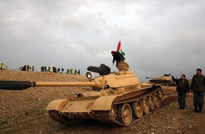Iraqi Kurdish soldier stands on a tank, flying the Kurdish flag, on Saturday. ( AFP PHOTO / SAFIN HAMED)