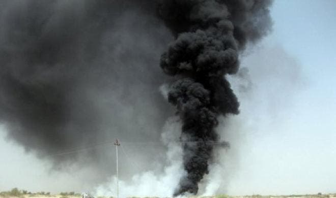 A column of black smoke billows from an oil pipeline about six kilometres (four miles) east of Marib in the eastern Yemeni province of the same name, after it was blown up by Yemeni tribesmen on June 12, 2010. Oil flow from a key Yemeni pipeline came to a halt on Thursday after tribesmen carried out a fresh attack on it, tribal sources and industry officials said.