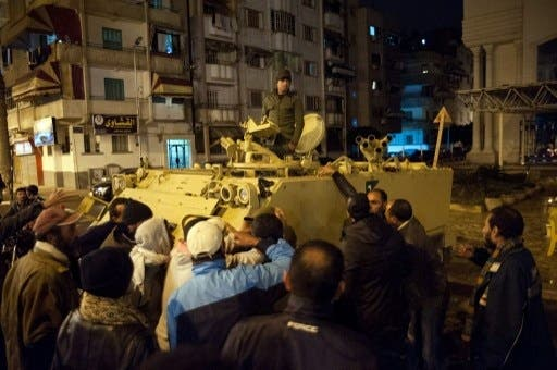 Egyptian protestors shout at a soldier standing in an armored personnel carrier as they demonstrate in the streets of the canal city of Port Said in late January (Photo: AFP / STR)
