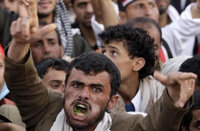 A Yemeni man chewing qat during a protest.