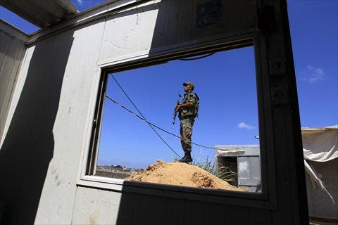 A Hamas policeman stands guard along the border with Egypt and the Palestinian territory on September 8, 2013 in the southern Gaza Strip city of Rafah. The Egyptian army has launched a major offensive against militants in the area. (AFP)