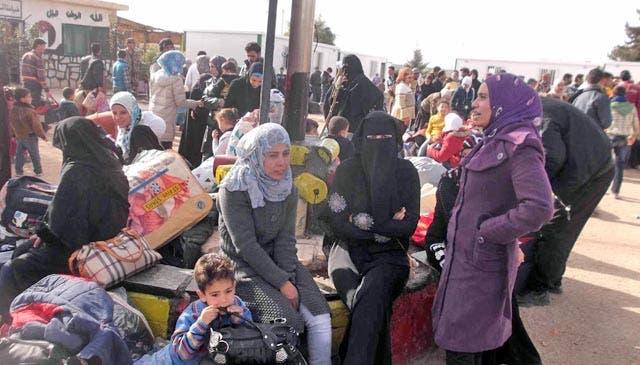Refugees gather in Jordan's Zaatari refugee camp (File Archive/AFP)