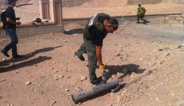 Man inspects a rocket that landed in Israel (used for illustrative purposes)
