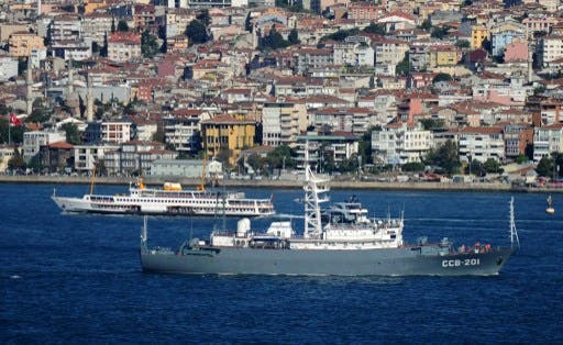 The Russian Navy CCB-201 vessel (front) sails in the Bosphorus on September 5, 2013 in Istanbul, on its way for intelligence operations off the coasts of Syria (AFP)