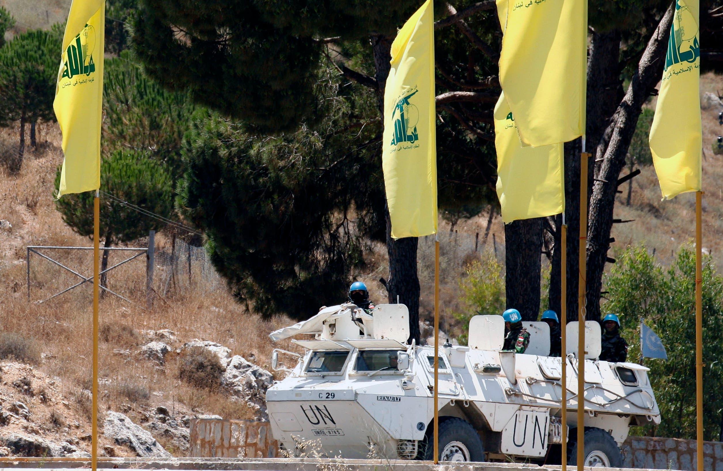 UN peacekeepers patrol past Hezbollah flags on July 23. (AFP / Mahmoud Zayyat)