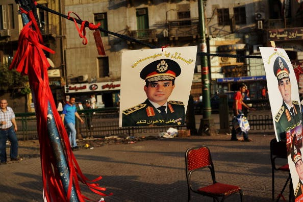 A picture of Egyptian military chief Abdel Fattah al-Sisi hangs in Tahrir Square. (Getty file photo)