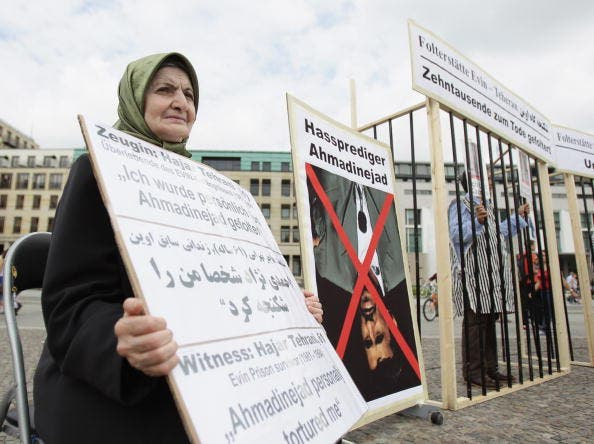 Witness Hajar Tehrani, Evin prison survivor (1981-1984), who was personally tortured by Iranian President Mahmoud Ahmadinejad, joins Iranian exiles protesting against stoning and condemns the forced concessions