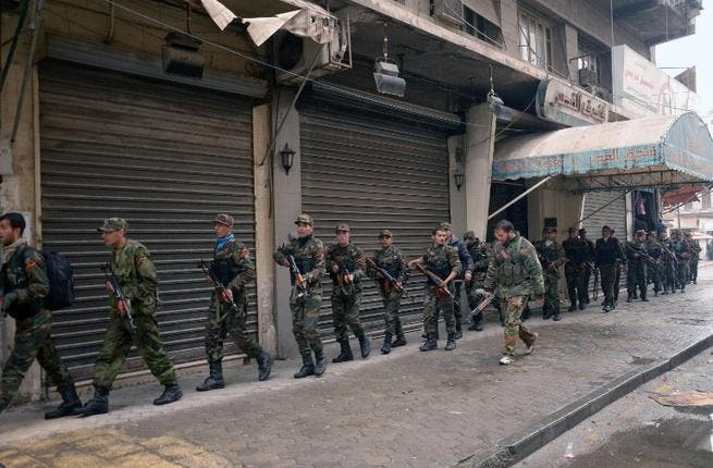 Syrian government forces deploy themselves in the streets of Syria's second city Aleppo. (AFP PHOTO / STR)