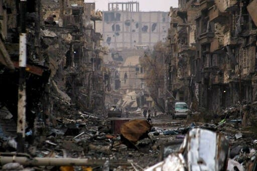 Rebel infighting has left many of Syria's northern cities in shambles (Ahmad Aboud/AFP)