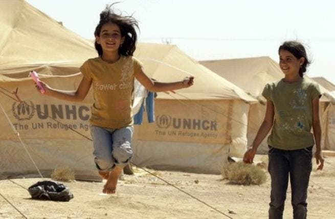 Syrian refugee children play at the Zaatari refugee camp close to the Jordanian city Mafraq, near the border with Syria