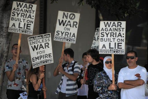 People demonstrate against a US-led strike on Syria in downtown Los Angeles on August 31, 2013. (AFP)