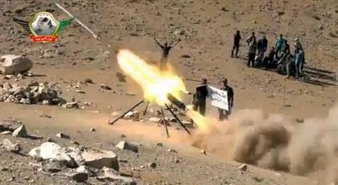 An image grab taken from a video uploaded on YouTube on May 29, 2013 allegedly shows members of the Al-Tawhid brigade firing missiles from Syria towards the Lebanese town of Hermel, a few kilometres from Baalbek in the Bekaa valley. AFP photo/YouTube