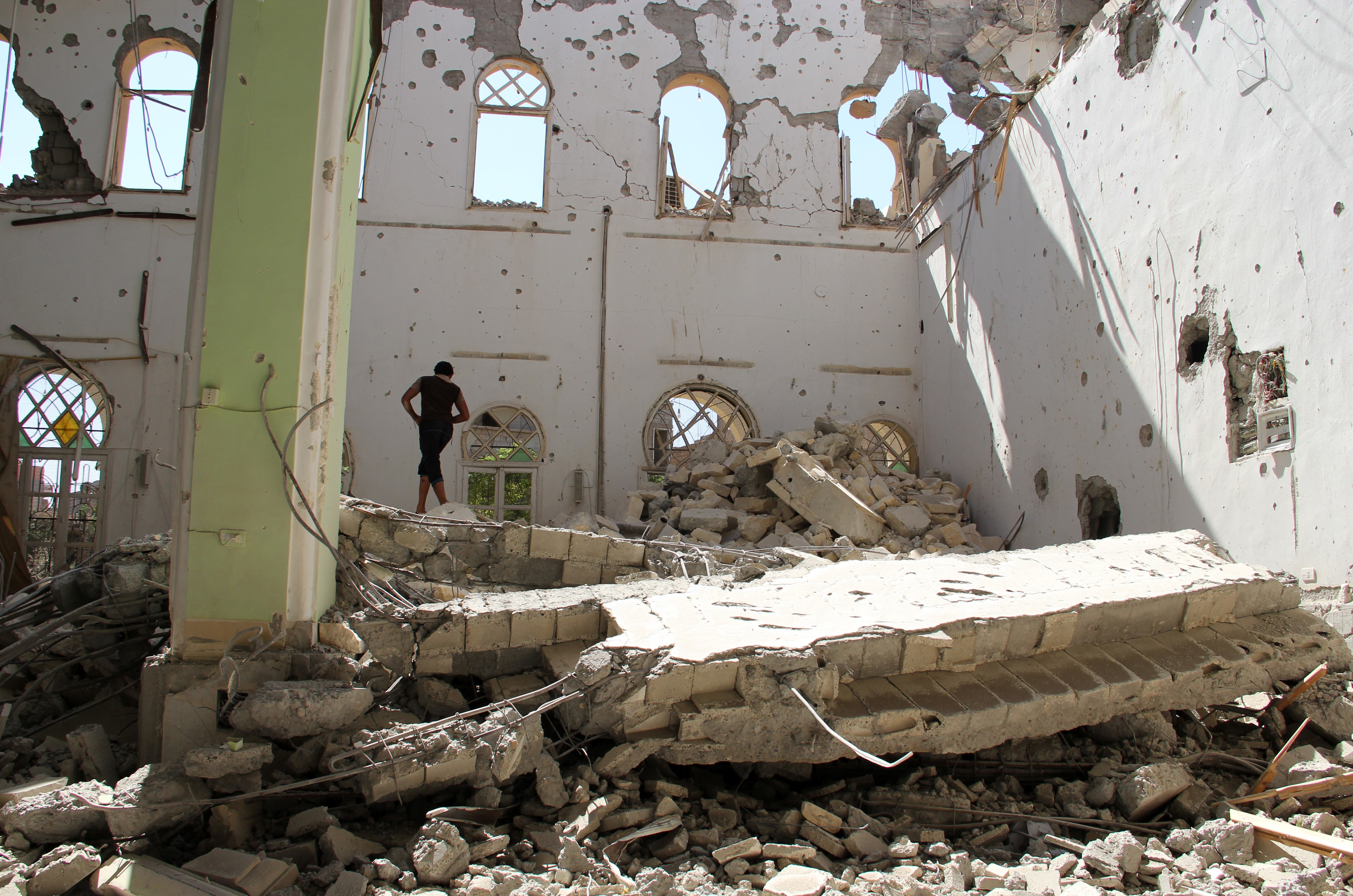 A man stands in the rubble of the Othman mosque, in Syria's eastern town of Deir Ezzor, on July 24. AFP / KARAM JAMAL