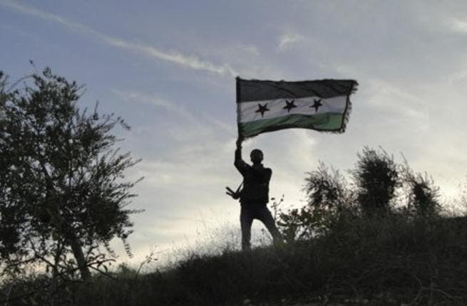 A Lebanese judge has issued an arrest warrant for a defected Syrian army colonel after he admitted to attempting to form an anti-Assad rebel brigade in north Lebanon. (AFP/File)