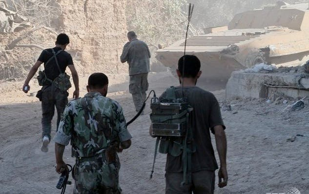 Syrian army soldiers are seen deployed in the Jobar neighbourhood of Damascus on August 24, 2013. (AFP)