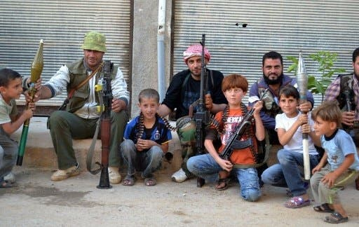 Members of the FSA pose with local children
