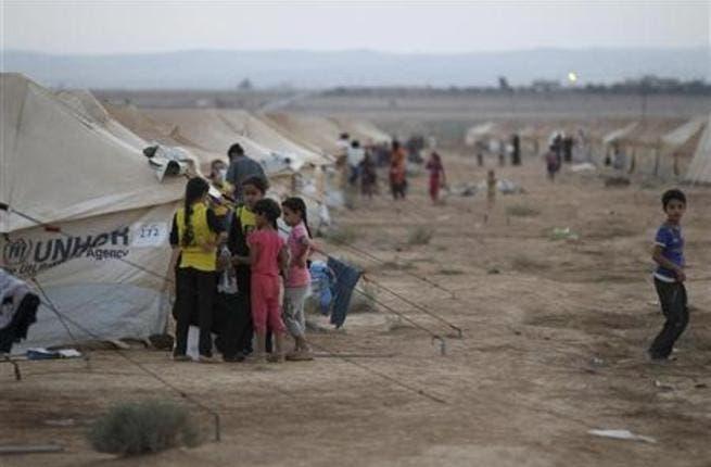 Syrian refugee children play in the Zaatari refugee camp in northern Jordan.